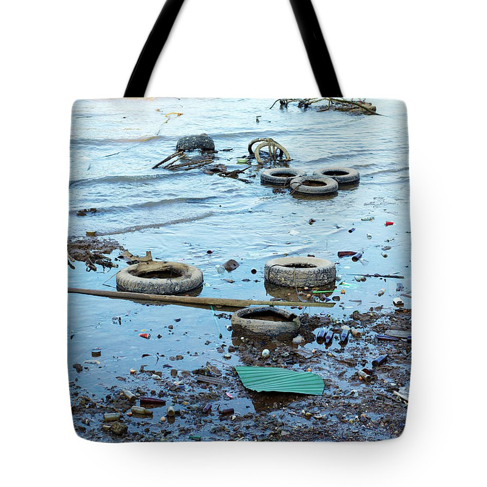 Water's Edge Tote Bag featuring the photograph Water Pollution by Drbouz