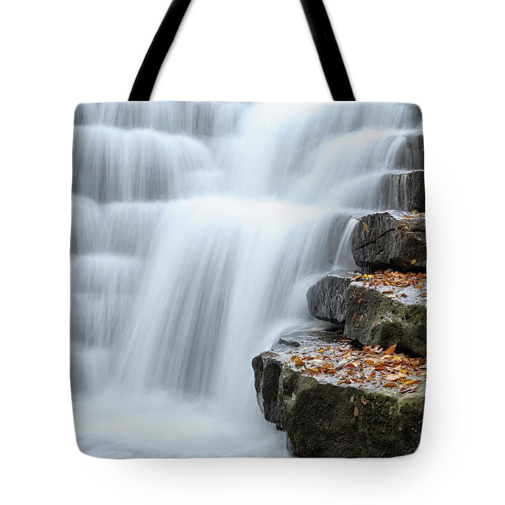Steps Tote Bag featuring the photograph Waterfall Flowing Over Rock Stair by Catnap72
