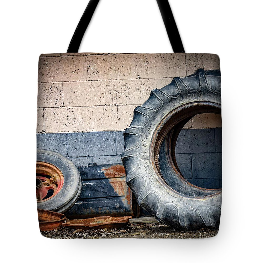 Tires Tote Bag featuring the photograph Wheels by Michelle Wittensoldner