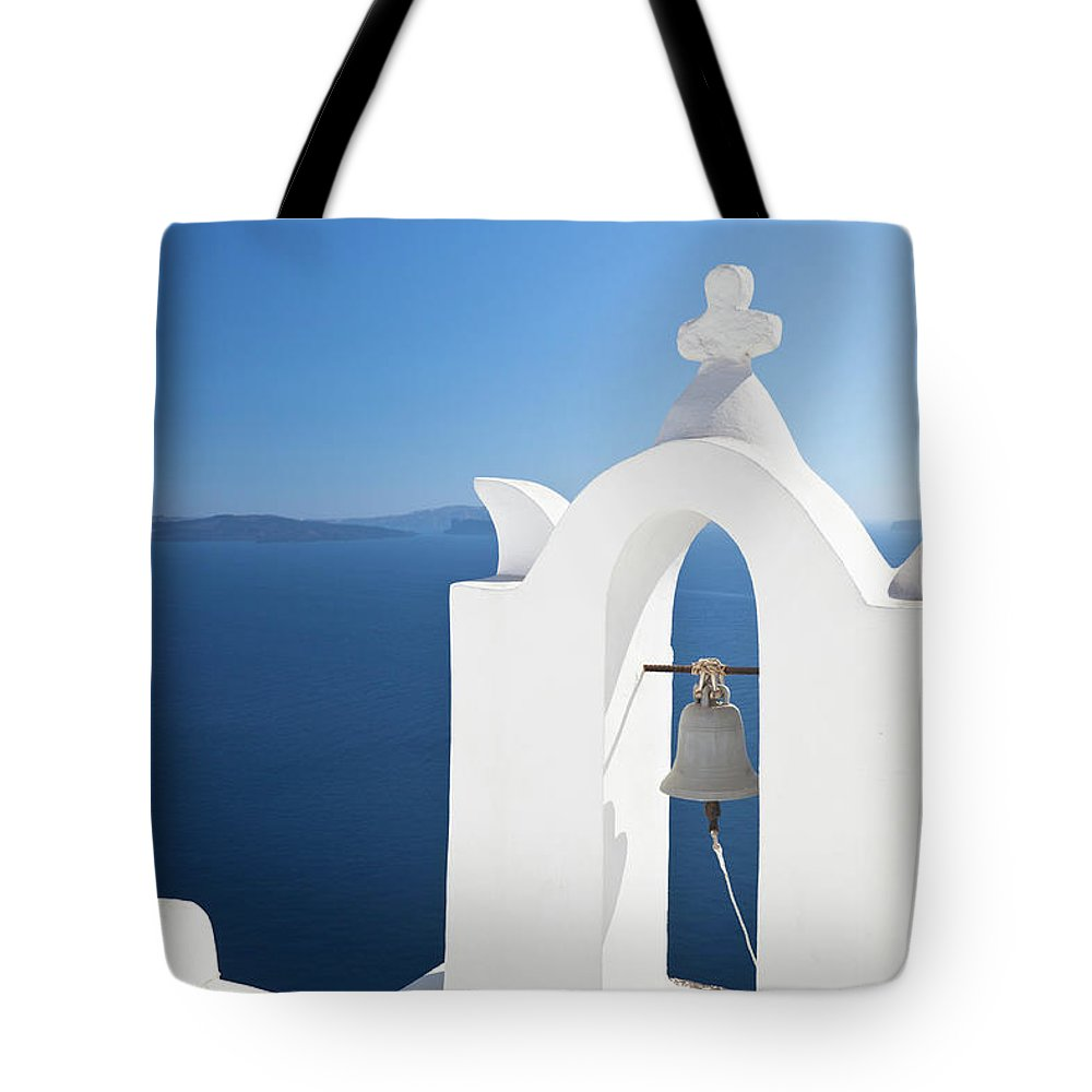 Greek Culture Tote Bag featuring the photograph White Bell Tower And Blue Sea by Michaelutech