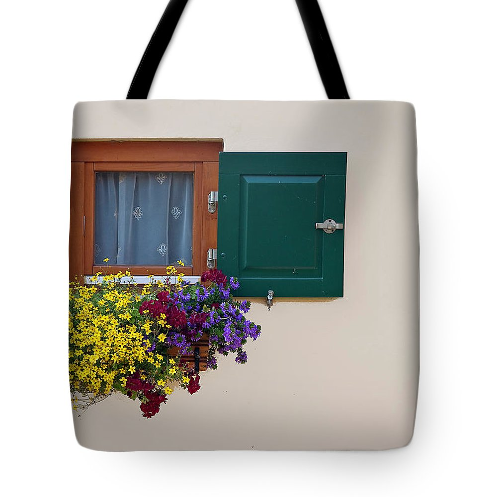 Outdoors Tote Bag featuring the photograph Window With Flowers by Enzo D.
