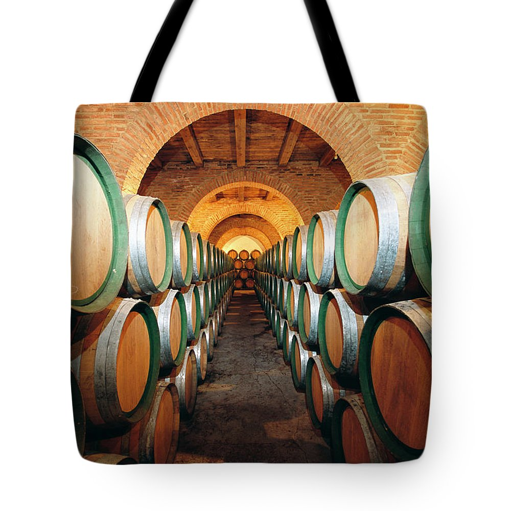 Working Tote Bag featuring the photograph Wine Barrels In Cellar, Spain by Johner Images