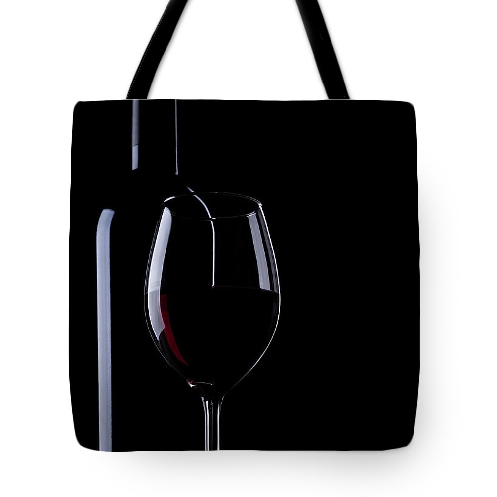 Curve Tote Bag featuring the photograph Wine Bottle And Glass by Portishead1