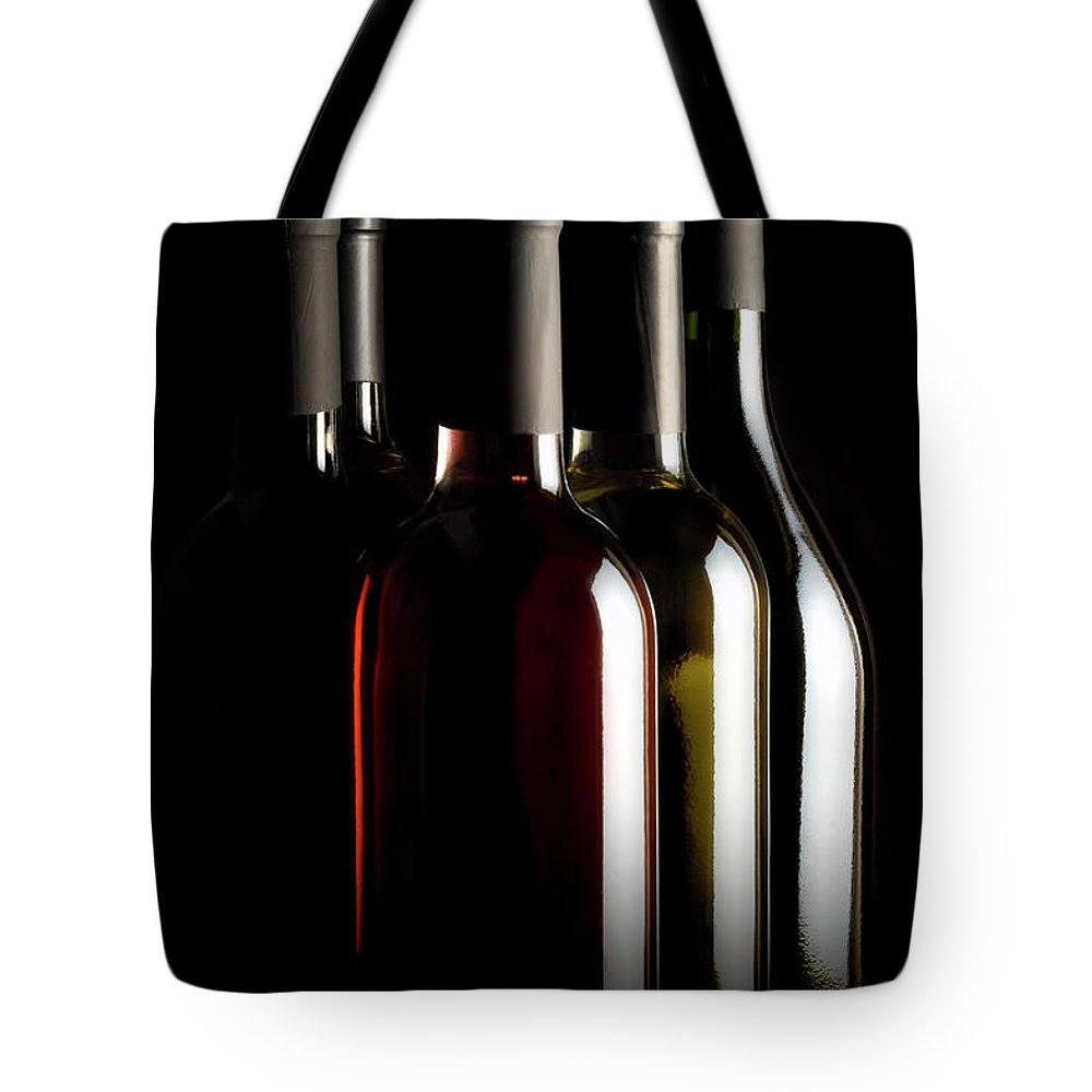 Rose Wine Tote Bag featuring the photograph Wine Bottles by Carlosalvarez