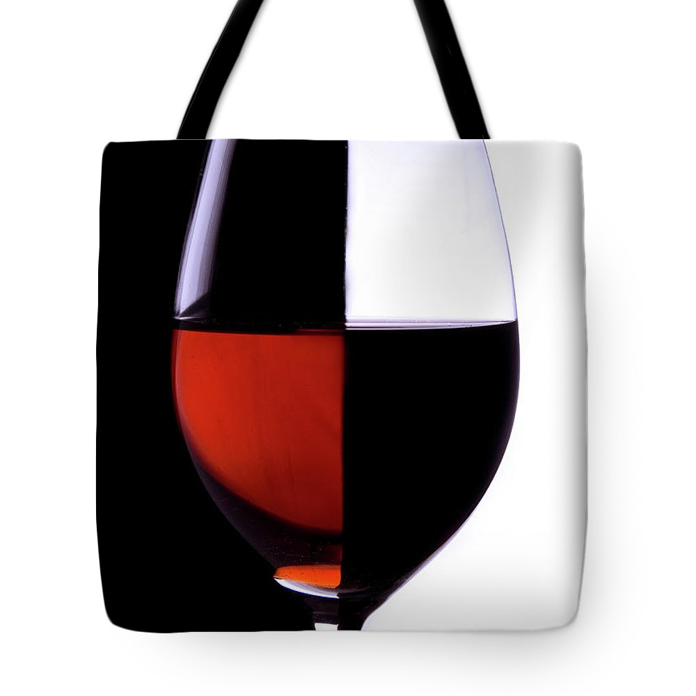 Alcohol Tote Bag featuring the photograph Wineglass by Portishead1