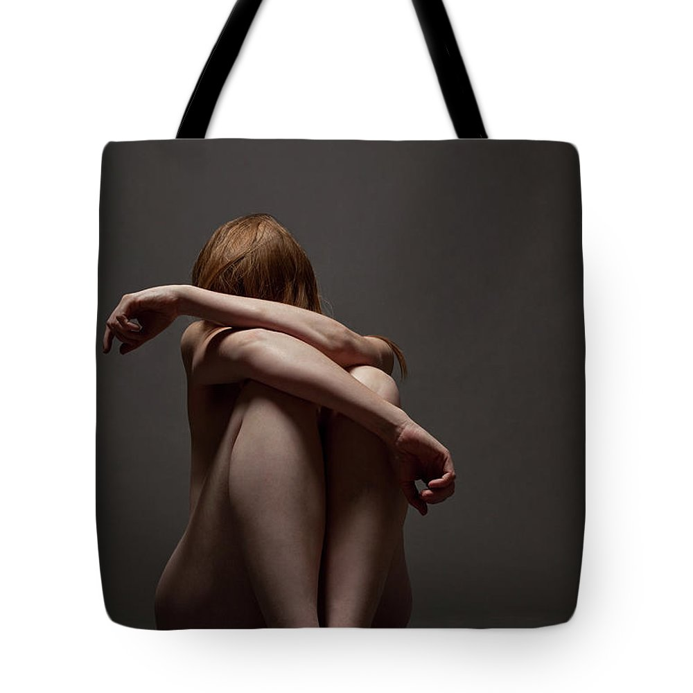 People Tote Bag featuring the photograph Woman Crouched On Floor by Claudia Burlotti