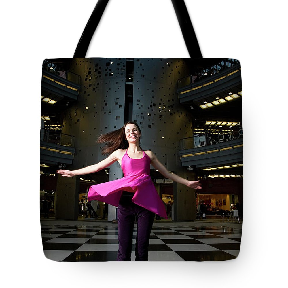 People Tote Bag featuring the photograph Woman Dancing In Old Brewery Shopping by Tim E White