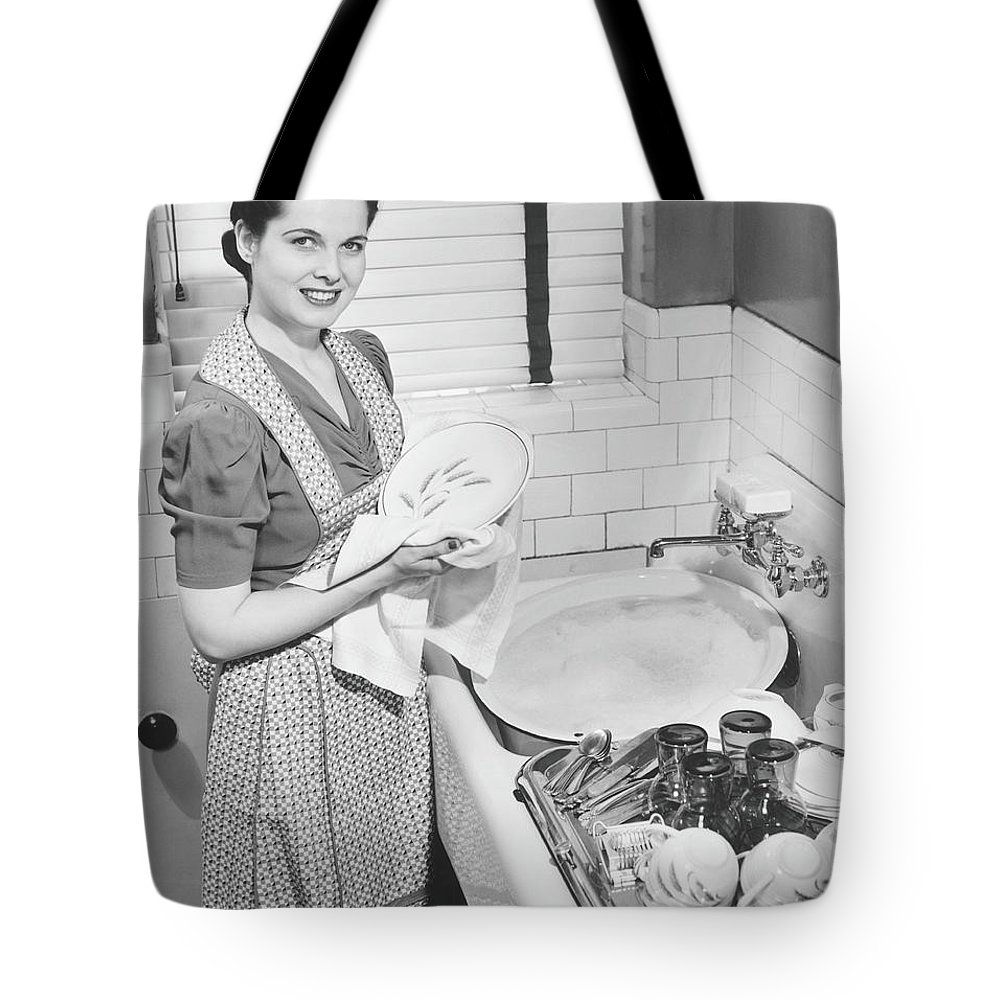 Three Quarter Length Tote Bag featuring the photograph Woman Drying Dishes At Kitchen Sink by George Marks