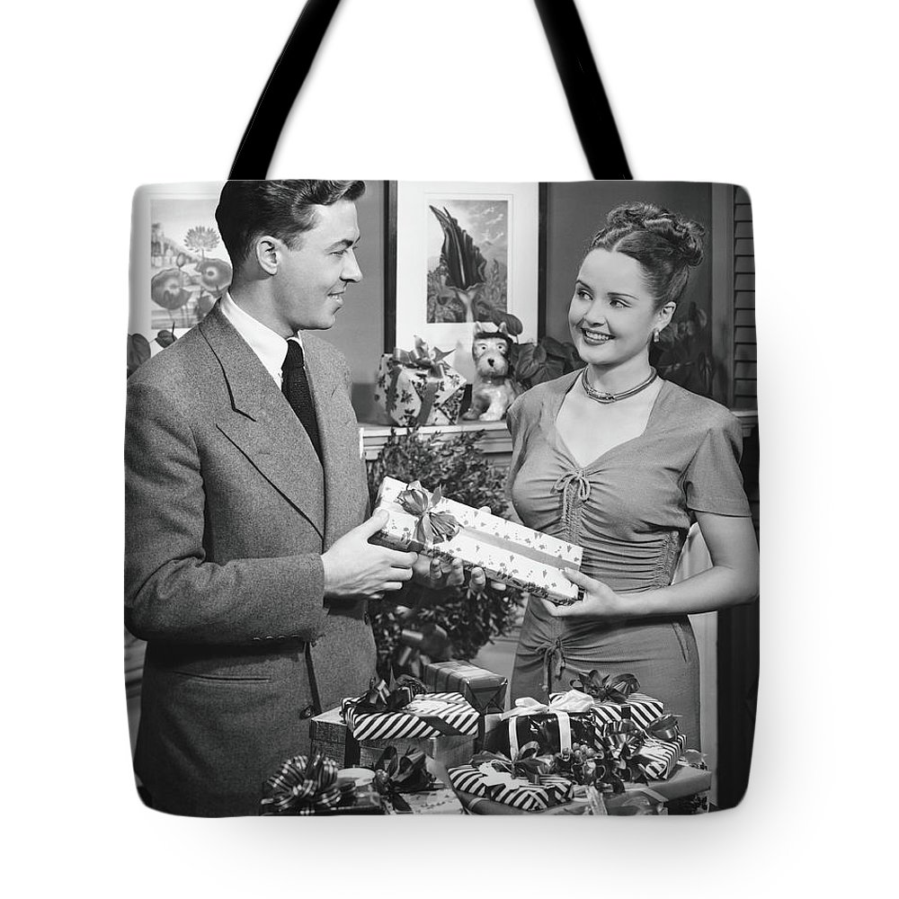 Heterosexual Couple Tote Bag featuring the photograph Woman Giving Gift To Man, B&w by George Marks