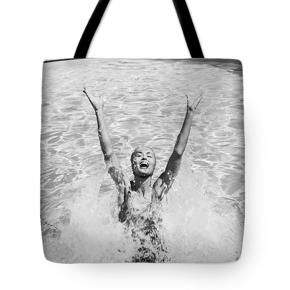 Human Arm Tote Bag featuring the photograph Woman Having Fun In Swimming Pool by Tom Kelley Archive