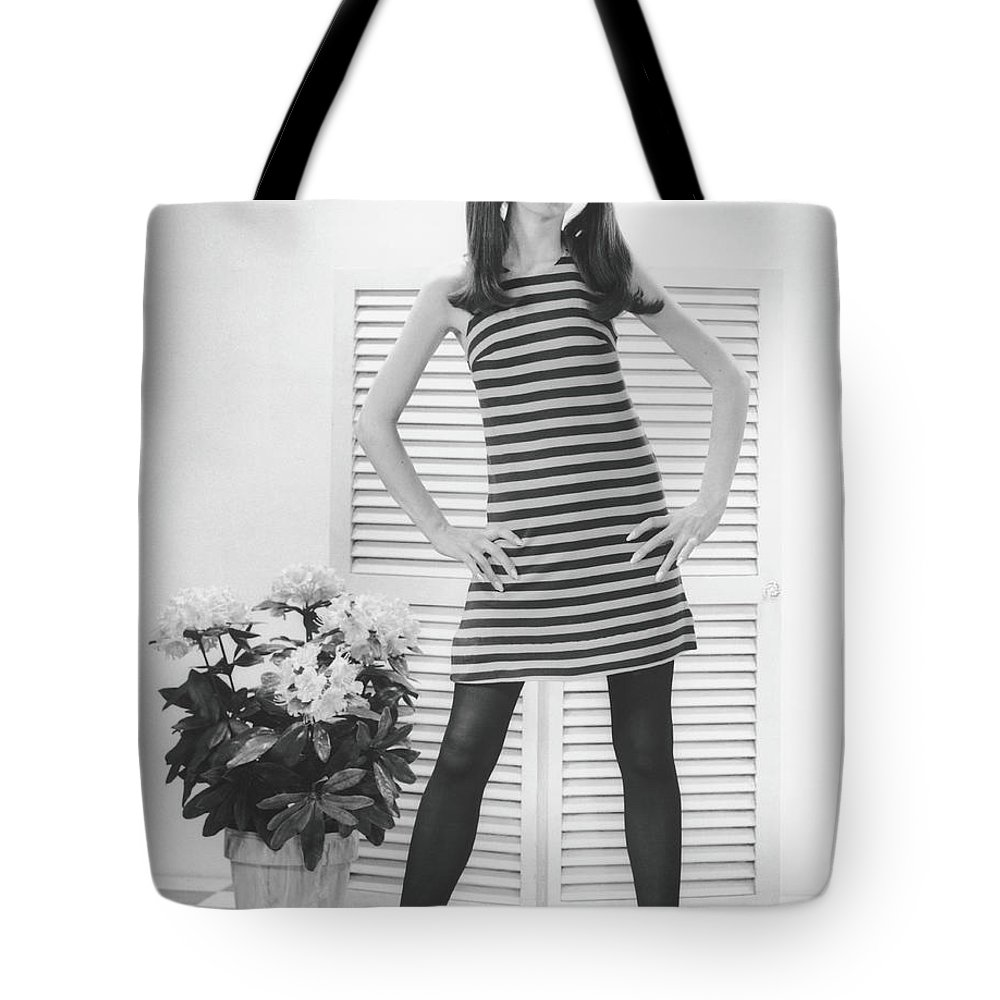 Cool Attitude Tote Bag featuring the photograph Woman Posing In Studio, B&w, Portrait by George Marks