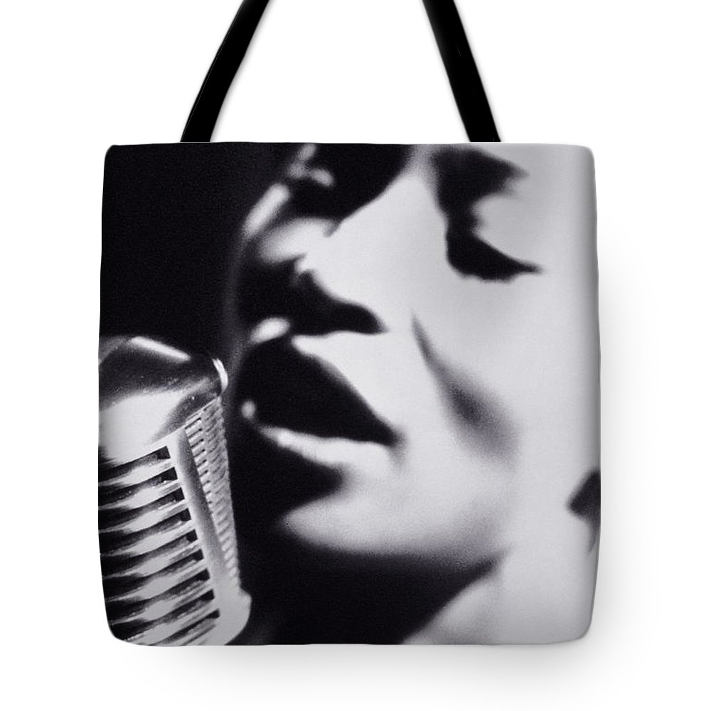 Singer Tote Bag featuring the photograph Woman Singing Into Microphone, Close-up by Nick Dolding