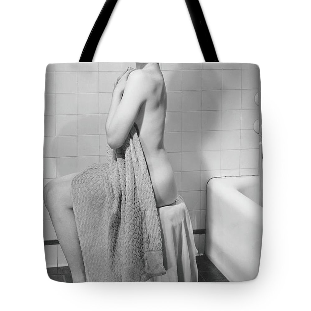 Looking Over Shoulder Tote Bag featuring the photograph Woman Sitting In Bathroom, Covering by George Marks