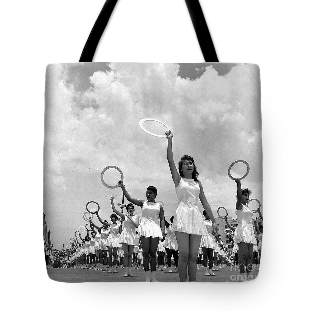 Women Tote Bag featuring the photograph Women And Rings by Venancio Diaz