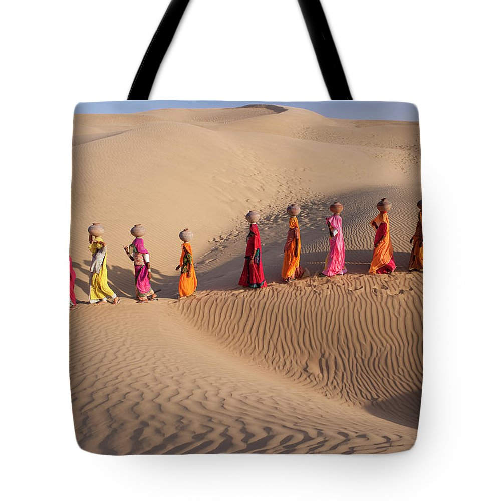 People Tote Bag featuring the photograph Women Fetching Water From The Sparse by Mint Images - Art Wolfe