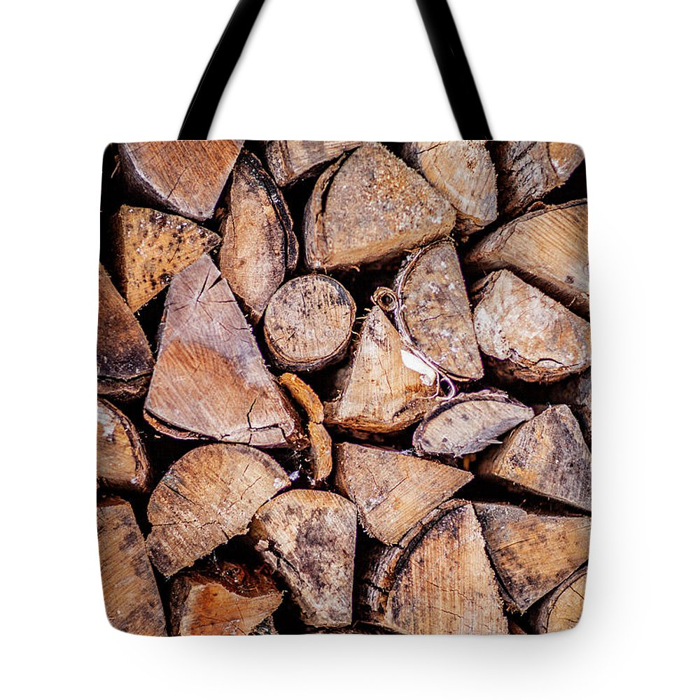 Wood Pile Tote Bag featuring the photograph Wood Pile by Trevor Slauenwhite