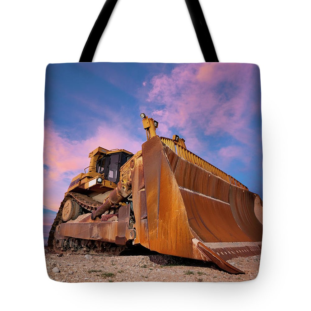 Toughness Tote Bag featuring the photograph Yellow Bulldozer Working At Sunset by Wesvandinter