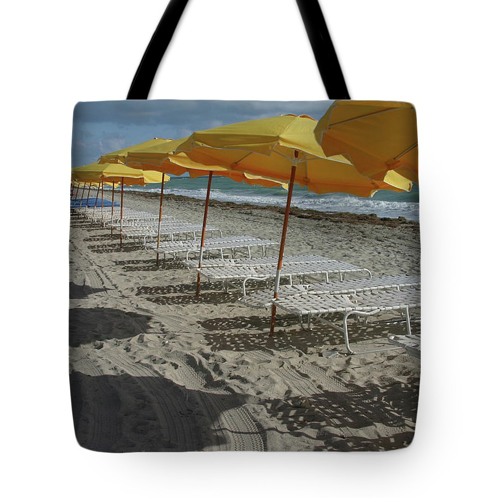 Shadow Tote Bag featuring the photograph Yellow Umbrellas In South Beach by Theresemck