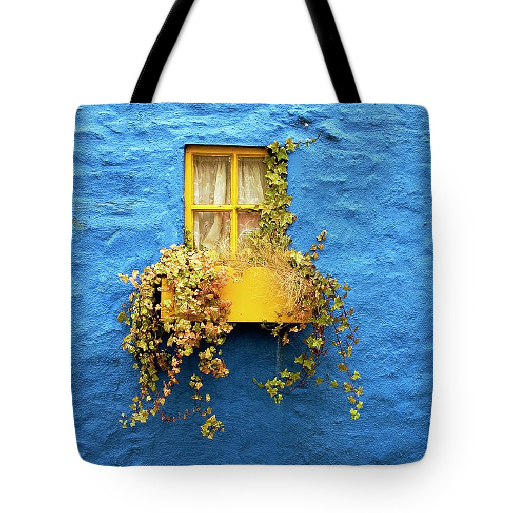 Outdoors Tote Bag featuring the photograph Yellow Window On Bright Blue Wall & by Sarah Franklin Www.eyeshoot.co.uk