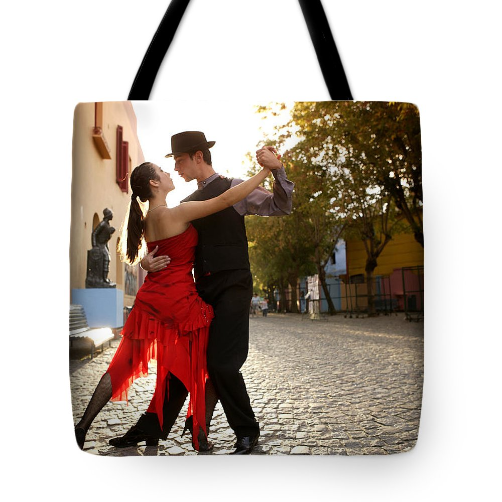 Young Men Tote Bag featuring the photograph Young Couple Dancing Tango In Street by Buena Vista Images