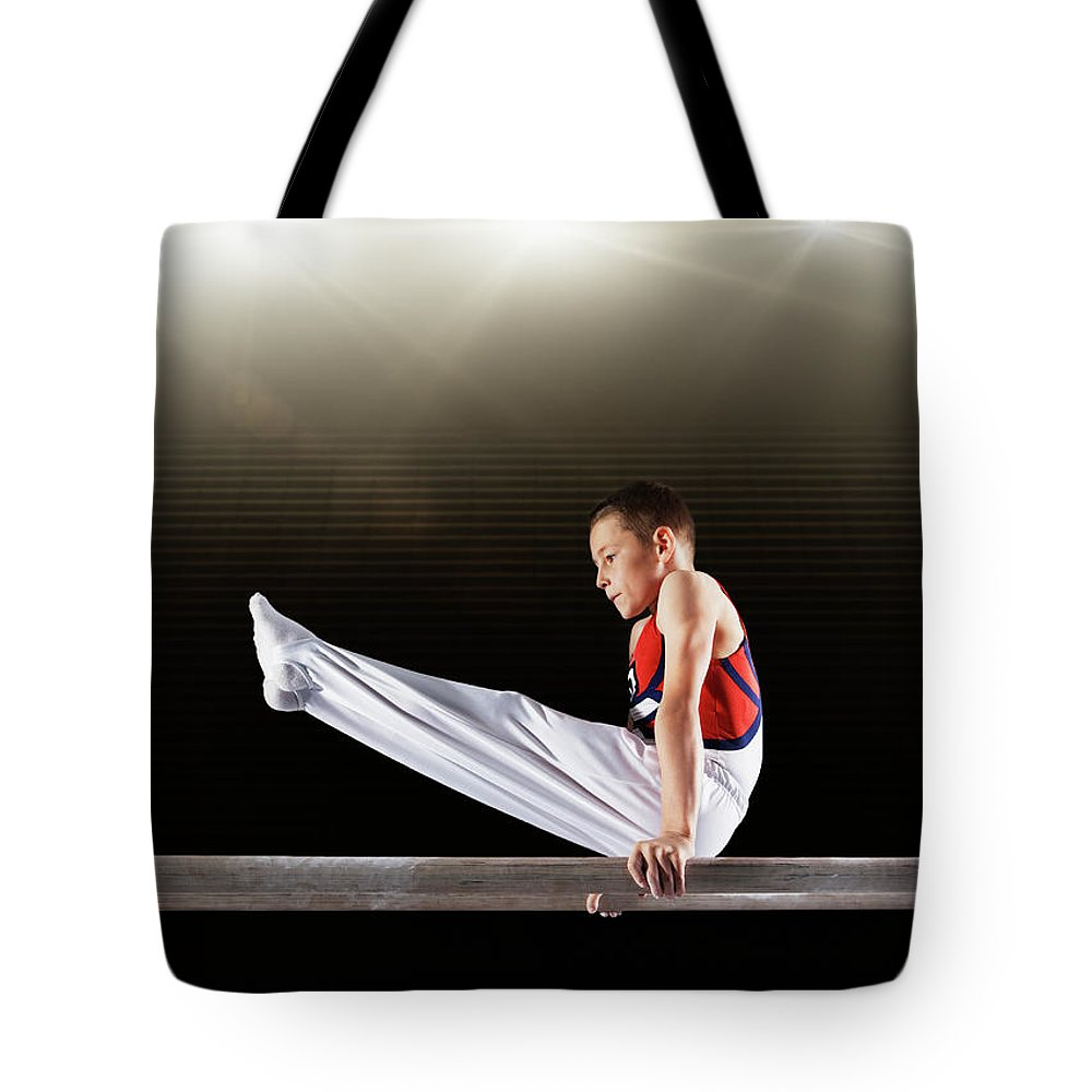 Focus Tote Bag featuring the photograph Young Male Gymnast Performing On by Robert Decelis Ltd