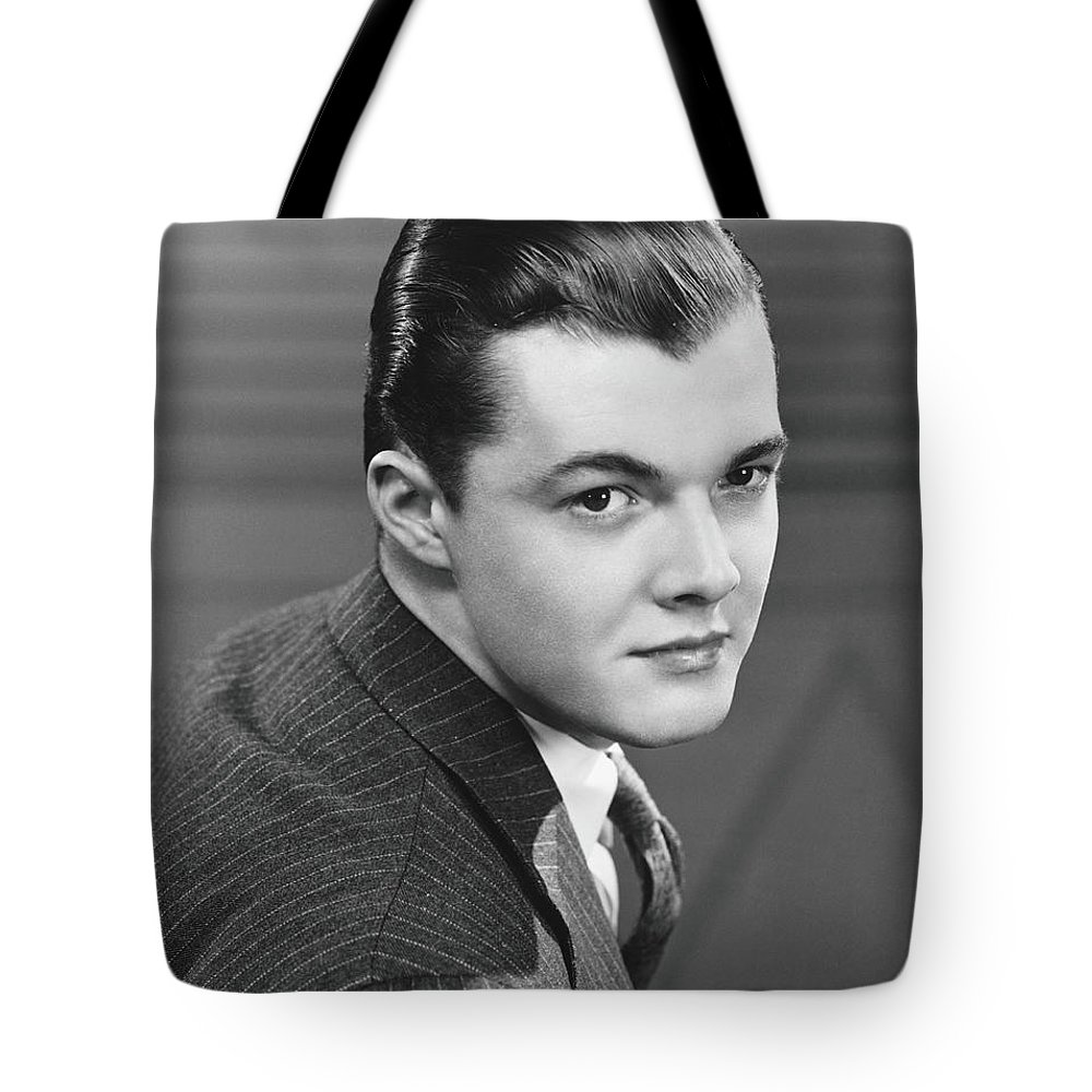 Young Men Tote Bag featuring the photograph Young Man Wearing Pinstripe Jacket by George Marks