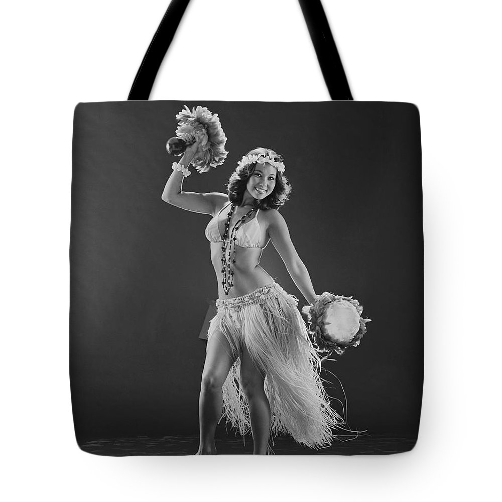 People Tote Bag featuring the photograph Young Woman Hula Dancer With Feathered by Tom Kelley Archive