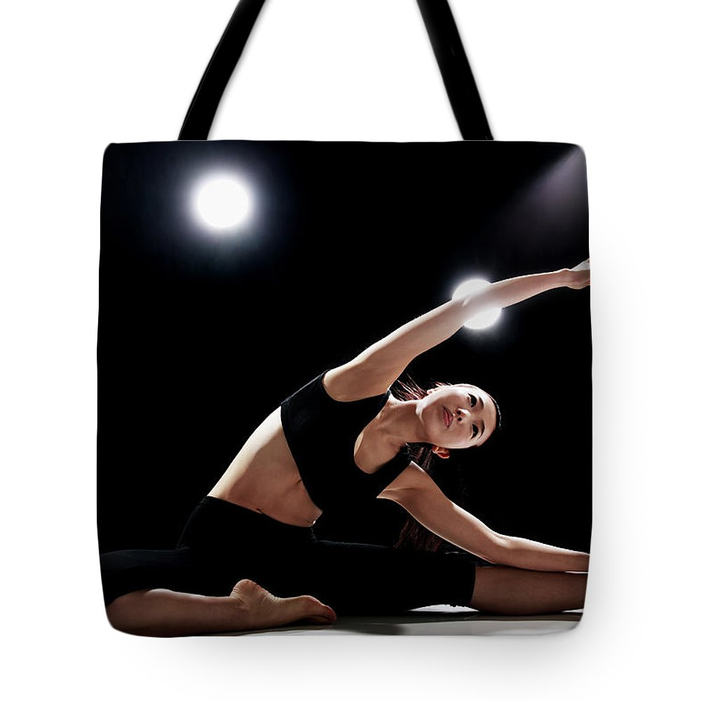 People Tote Bag featuring the photograph Young Woman Stretching by Runphoto