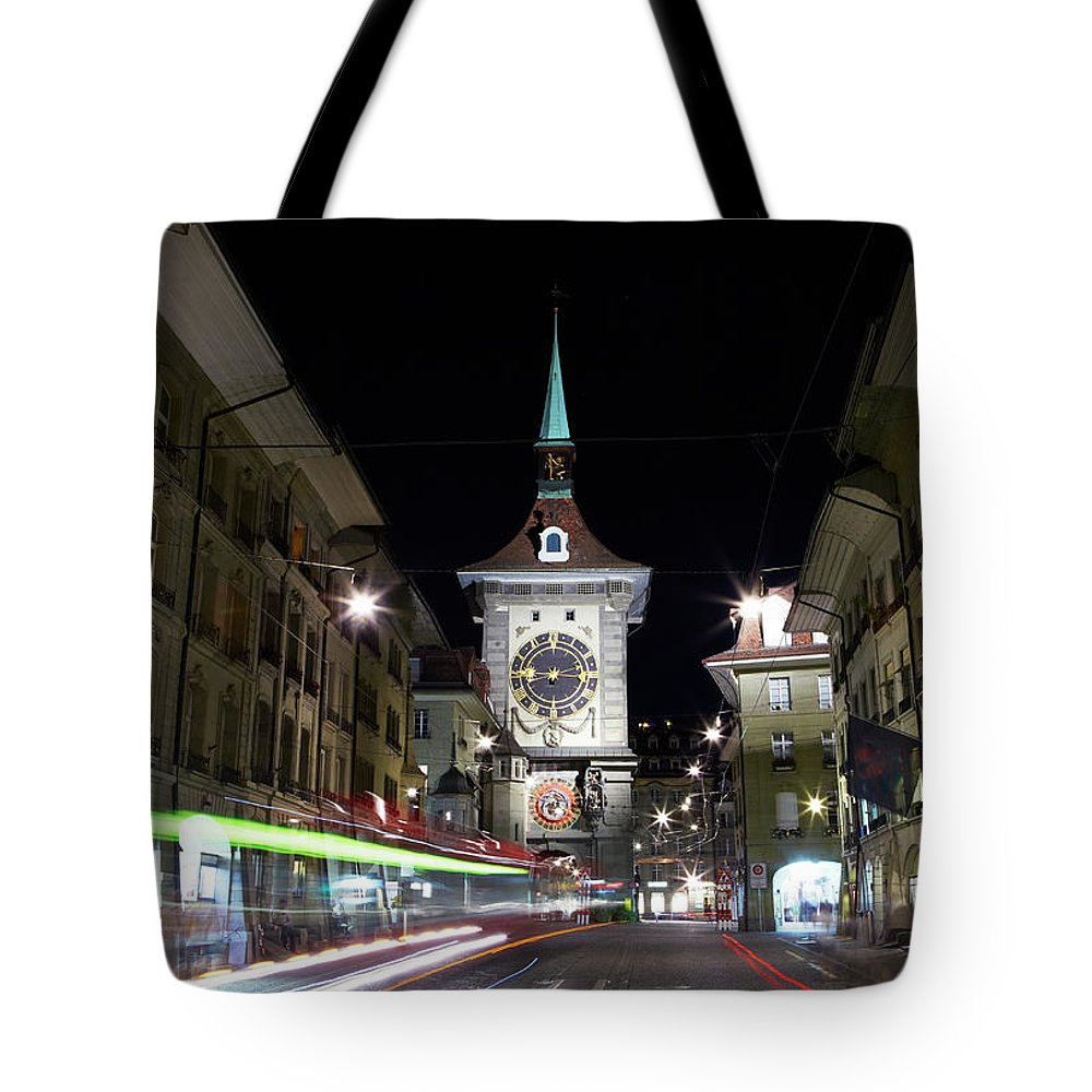 Clock Tower Tote Bag featuring the photograph Zytglogge Tower At Night by Allan Baxter