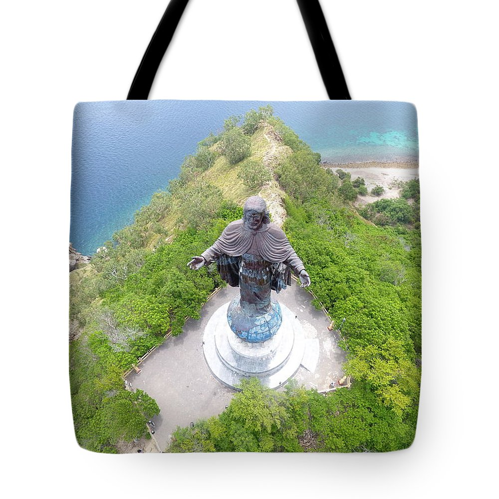 Travel Tote Bag featuring the photograph Cristo Rei of Dili statue of Jesus by Brthrjhn2099