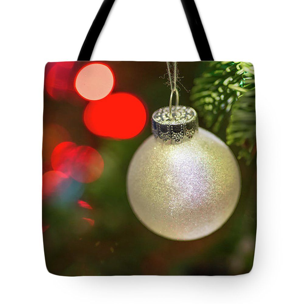 Ball Tote Bag featuring the photograph Christmas Ornaments With Bokeh Background by Ognian Setchanov