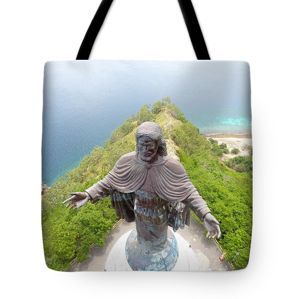Adventure Tote Bag featuring the photograph Cristo Rei of Dili statue of Jesus by Brthrjhn2099