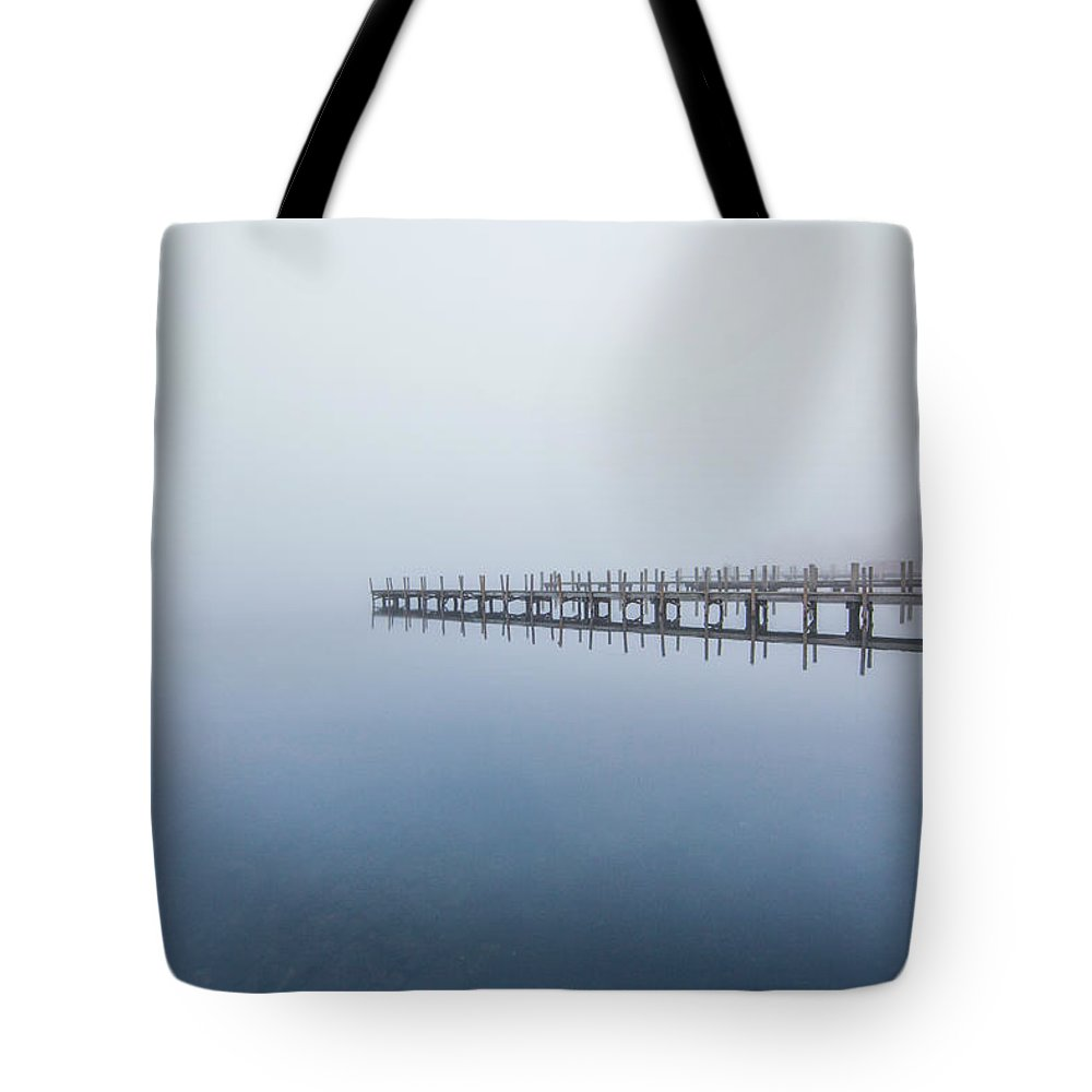 Docks Tote Bag featuring the photograph Docks by Trevor Slauenwhite