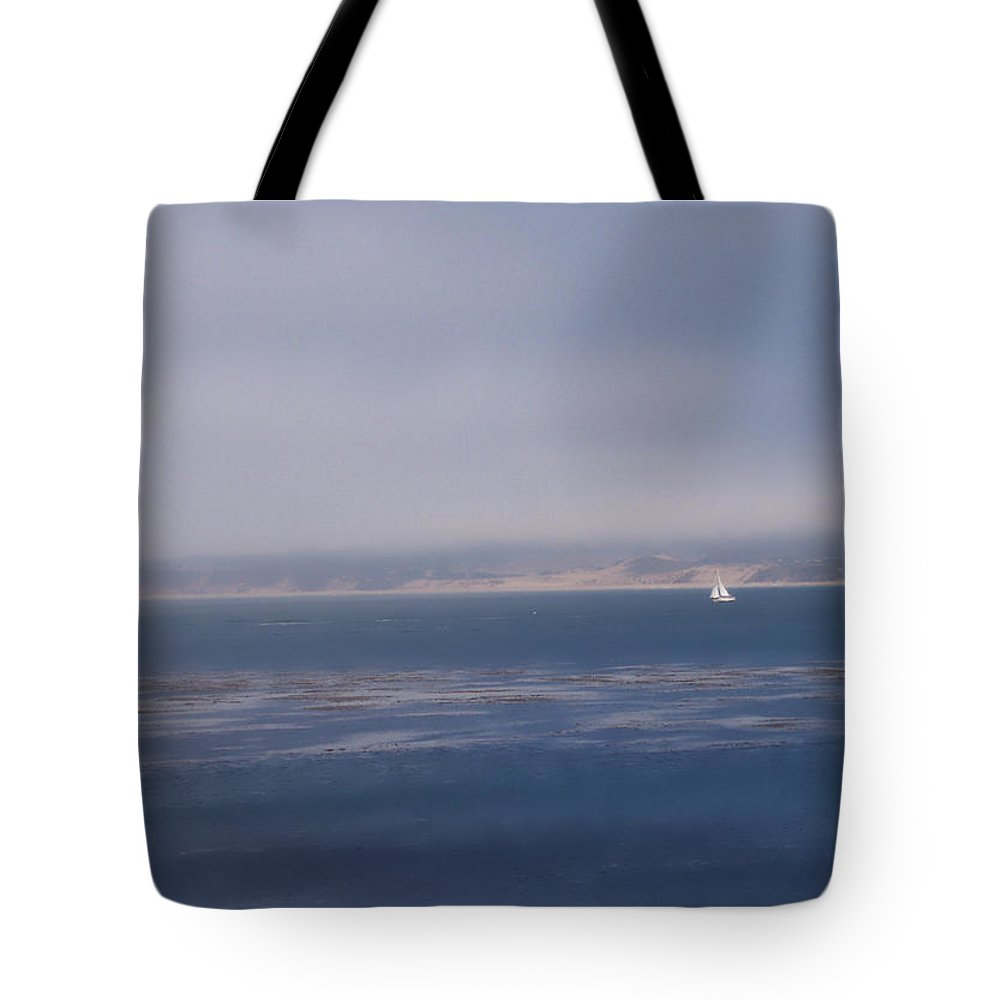 Sail Tote Bag featuring the photograph Solo Sail in Monterey Bay by Pharris Art
