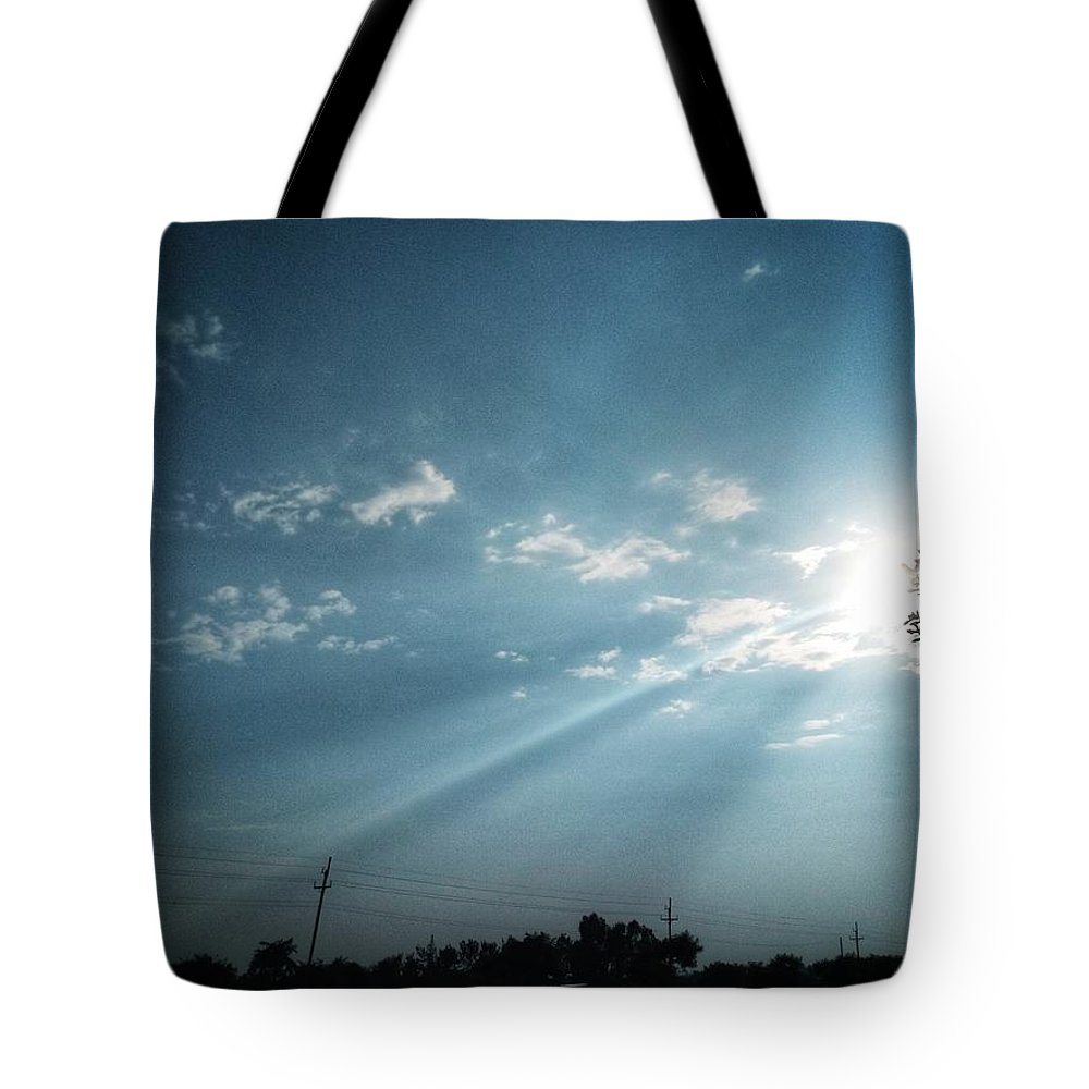 Sky Tote Bag featuring the photograph Striking rays by Yvonne's Ogolla
