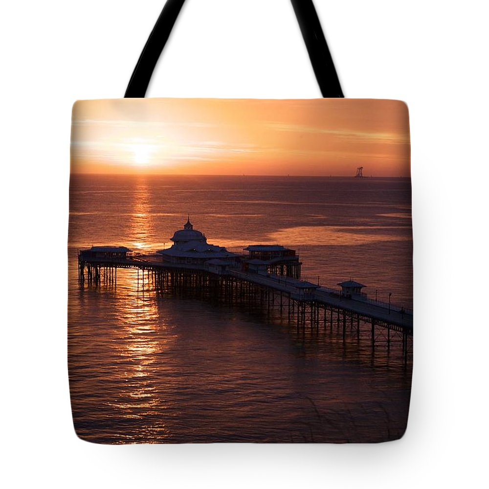 Piers Tote Bag featuring the photograph Sunrise over Llandudno pier 2 by Christopher Rowlands