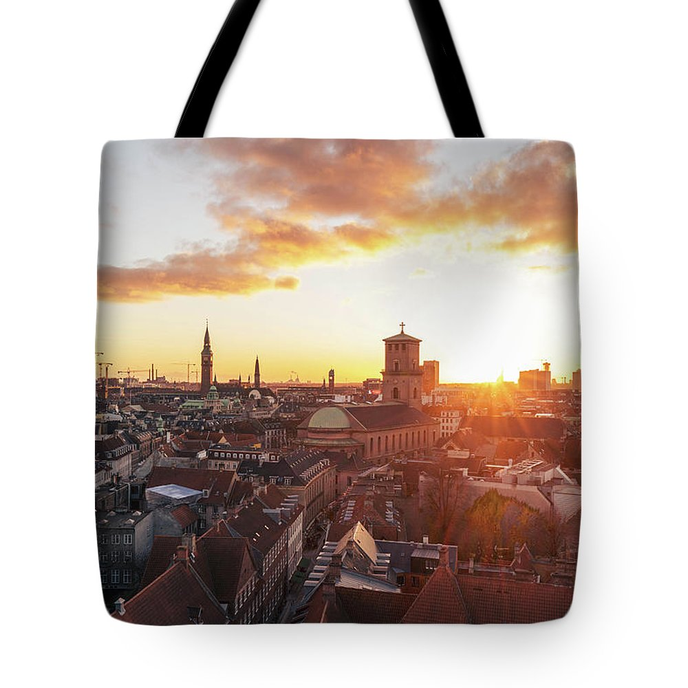 City Tote Bag featuring the photograph Sunset above Copenhagen by Hannes Roeckel