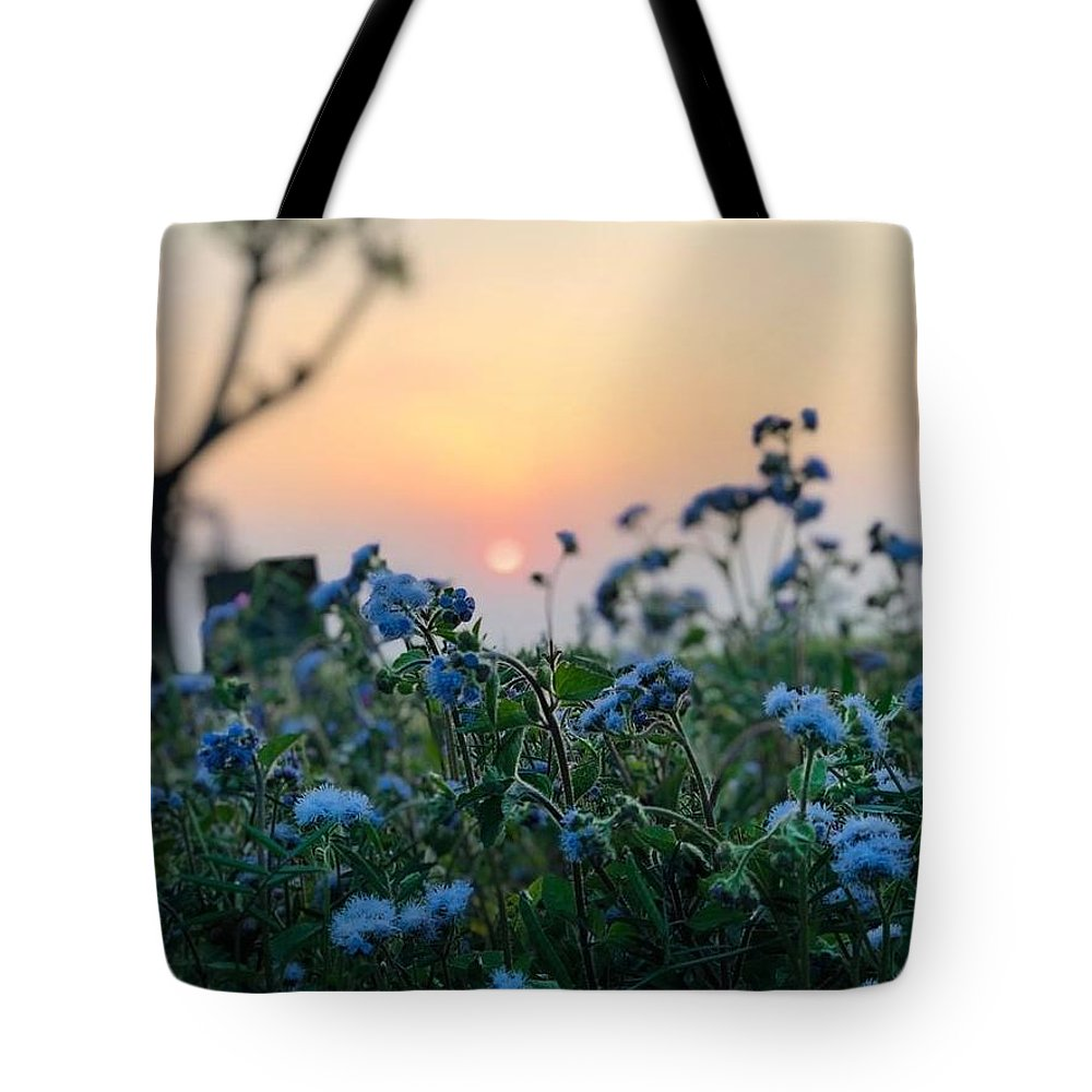 Flowers Tote Bag featuring the photograph Sunset Behind Flowers by Prashant Dalal