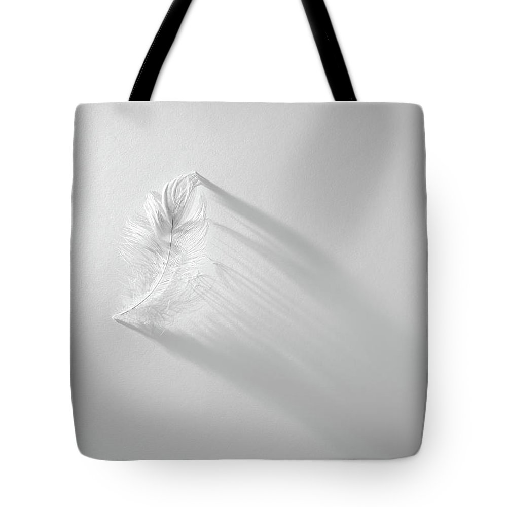 Feather Tote Bag featuring the photograph White Feather by Scott Norris