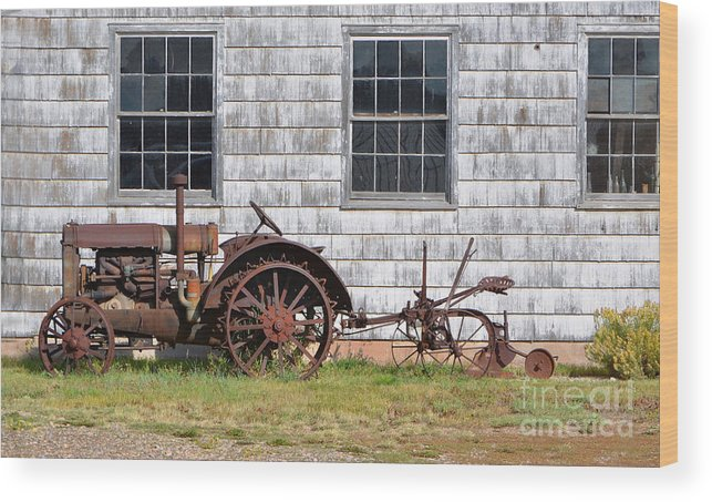 Fine Art Wood Print featuring the photograph Old Farm Equipment by Donna Greene