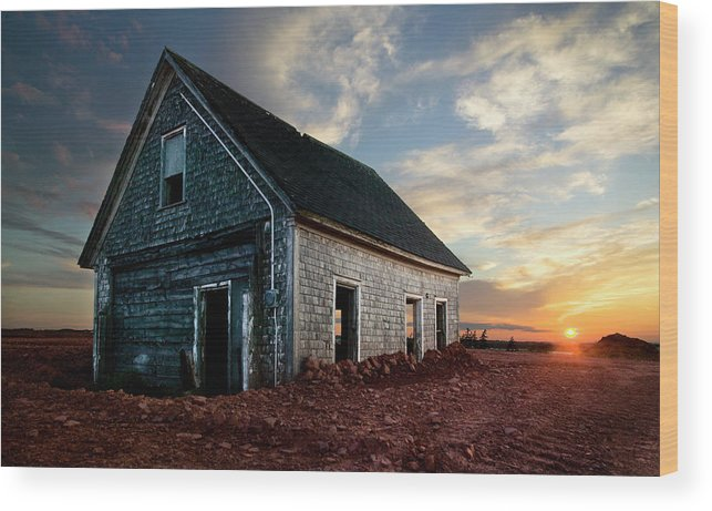 Abandoned Wood Print featuring the photograph An Old Farm House Sits Partially Buried by Robert van Waarden
