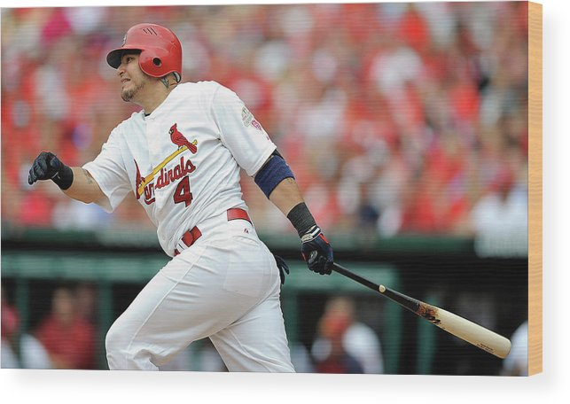 Following Wood Print featuring the photograph Yadier Molina by Jeff Curry
