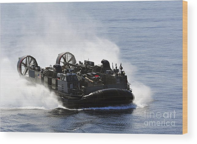Assault Craft Wood Print featuring the photograph A Landing Craft Air Cushion Transits by Stocktrek Images