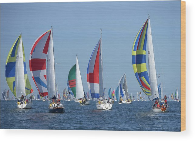 Tranquility Wood Print featuring the photograph Yachts Flying Spinnakers During Race by Simon Battensby