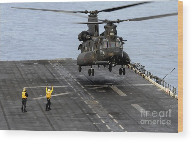 Military Wood Print featuring the photograph An Army Mh-47g Chinook Conducts Deck by Stocktrek Images