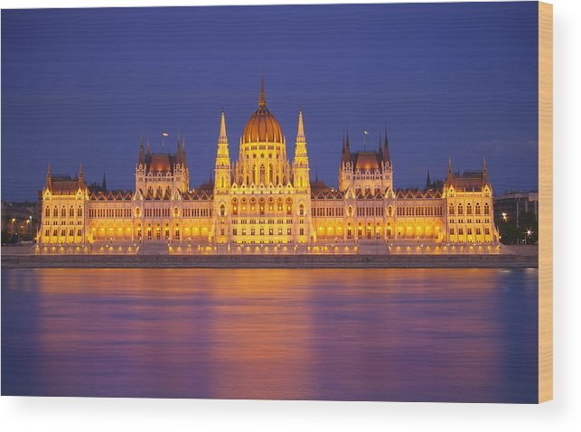 Architecture Budapest Building Capital City Cityscape Danube Dark Dome Duna Europe Evening Famous Flag Flowing Government House Hungarian Hungary Landmark Landscape Light National Night Old Panorama Parliament Pest Place Reflection River Riverside Scene Sight Sightseeing Sky State Tour Tourism Tourist Town Travel Urban View Water Wood Print featuring the photograph Budapest Parliament At Night by Ioan Panaite