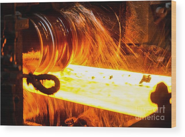Steel Wood Print featuring the photograph Rolling A Rail At A Steel Mill by Ria Novosti