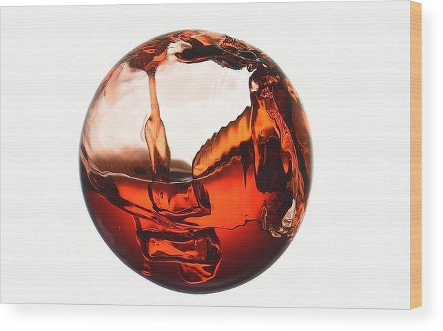 Liquid Wood Print featuring the photograph Liquid Sphere by Gianfranco Merati