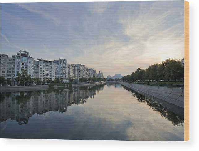 Bucharest; Bucuresti; Buildings; Capital; Cars; Clouds; Dambovita; Landscape; Municipal; Panorama; River; Sky; Town; Trees; View; Reflection; Water; Wide; Parliament; Building; Sunset; Wood Print featuring the photograph Bucharest by Ioan Panaite