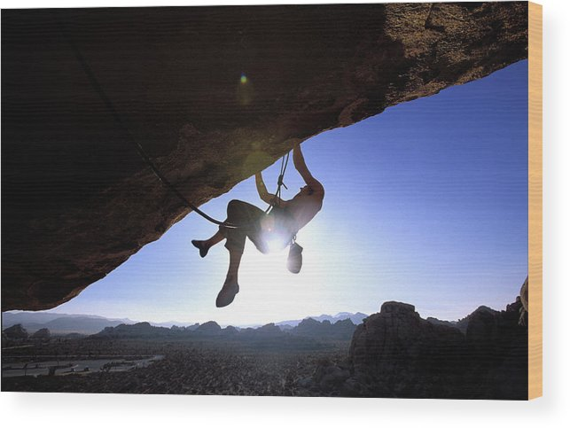 Action Wood Print featuring the photograph Man Climbing On An Overhang In Joshua by Corey Rich